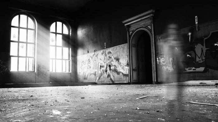 A ghostly black and white photo of an old school